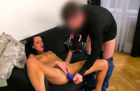 Purple dildo is in the pussy and asshole of a gorgeous brunette. She loves to get roughly banged.